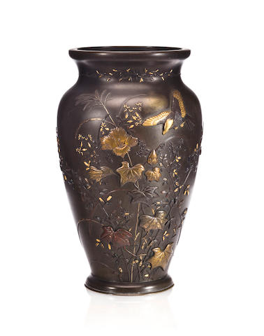 A bronze vase with a mixed-metal design of birds