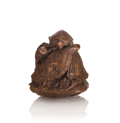 A wood netsuke of a turtle group