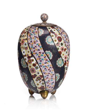 A cloisonné enamel ovoid vase and cover on tripod feet