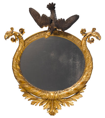 A Classical parcel ebonized giltwood mirror<BR />American or English, first quarter 19th century