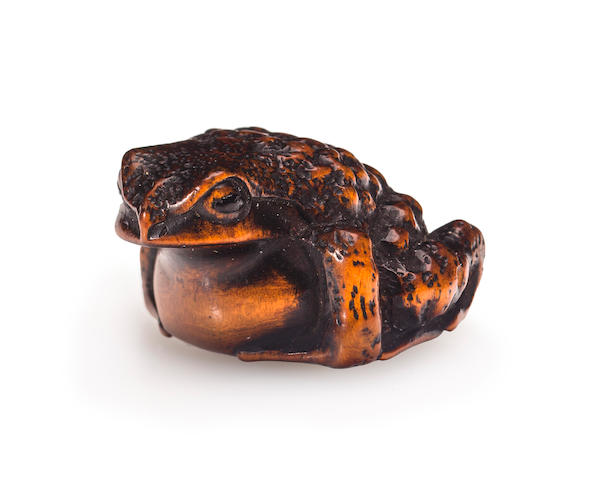 A stained wood netsuke of a toad By Masanao of Ise, Edo period (19th century)