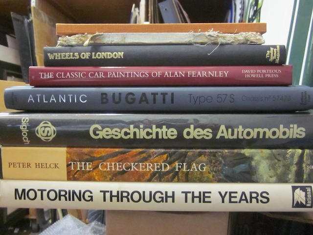 A large lot of books on auto history and art featuring Peter Helcks 'Checkered Flag.'