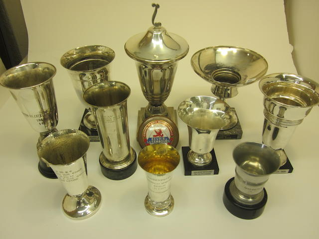 A collection of trophies  featuring an honorary mention at Avus-Rennen and a first place Winter Hill climb to Leo Levine,
