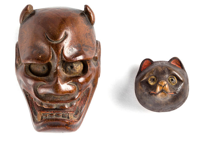 Two wood mask netsuke The second by Kozan, 19th century