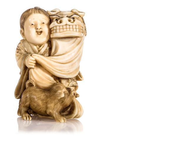 Ivory netsuke of boy with dog and dragon