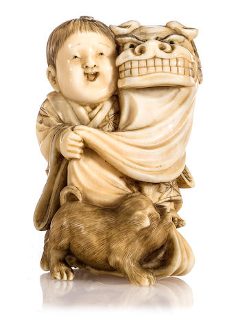 Ivory netsuke of boy with dog and dragon