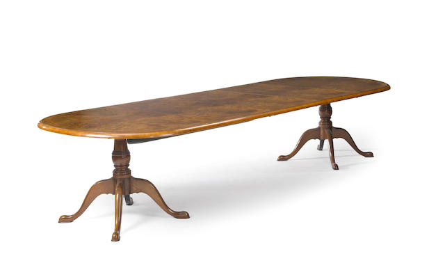 A George III style crossbanded walnut and burl walnut double pedestal extension dining table <BR />20th century