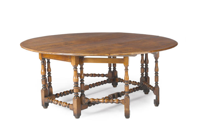 A William and Mary style oak and figured walnut gate leg dining table<BR />partially incorporating antique elements