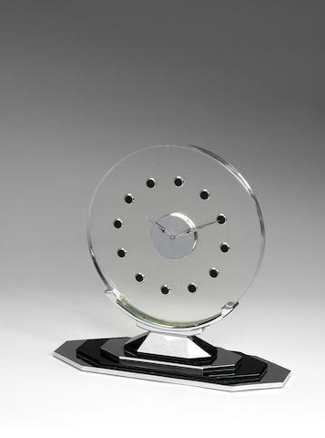 A circular glass clock supported on a nickel plated metal and black glass base Adnet, French C 1930