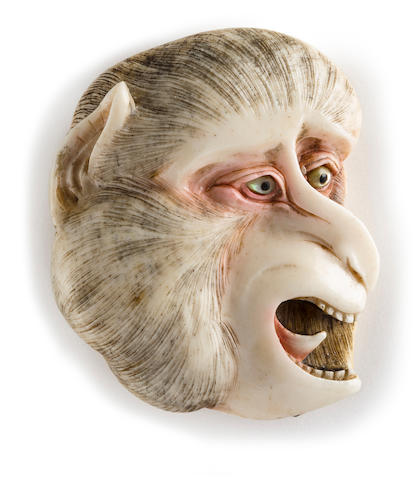 Bone manju netsuke of a monkey's face