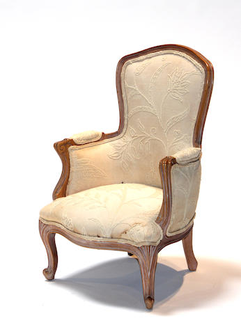 A Louis XV style beechwood child's bergere 20th century