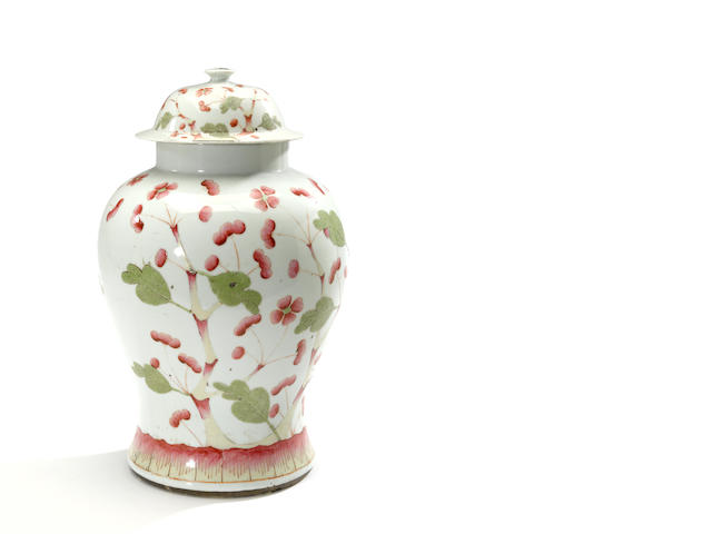 A polychrome enameled porcelain jar with lid height 17in