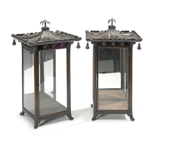 A pair of chinoiserie ebonized wood and glass pagoda form table cabinets <BR />20th century