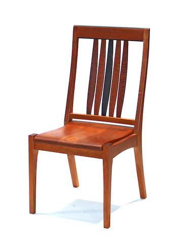 A pair of contemporary ebonized and mixed hardwood chairs