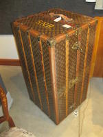 A vintage Louis Vuitton hardsided trunk