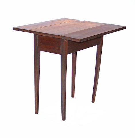 A Federal birch drop leaf table early 19th century