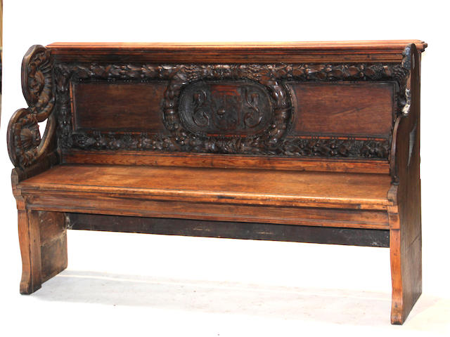 An English oak heraldic bench