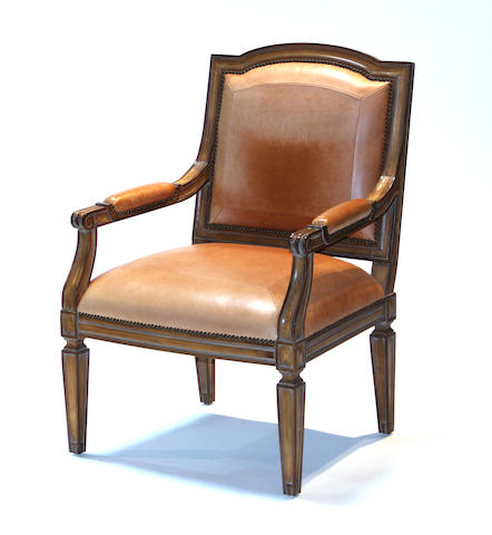 A pair of Neoclassical style leather upholstered armchairs 20th century