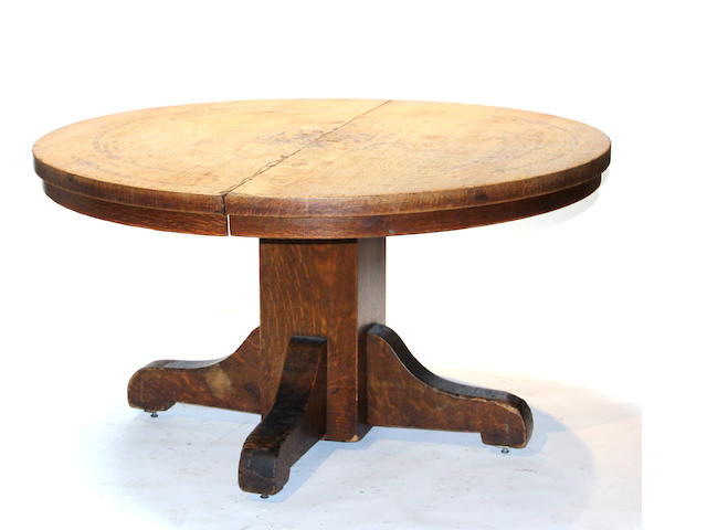 An American golden oak dining table late 19th/early 20th century