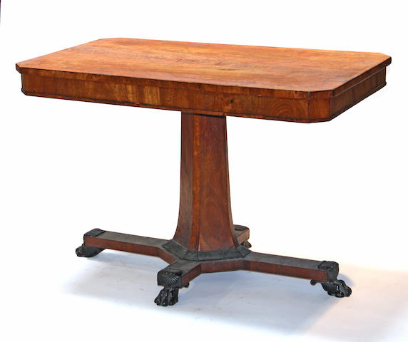 A Classical style mahogany center table together with an Edwardian mahogany bowfront chest of drawers late 19th/early 20th century