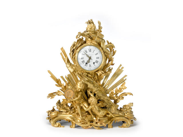 A fine Louis XV style gilt bronze figural mantel clock: Pendule &#224; la Gloire du Roi <BR />after a model by Edm&#233;-Jean Gallien (French, 1720-1797)<BR />dial signed Paul Sormani, Paris<BR />late 19th century