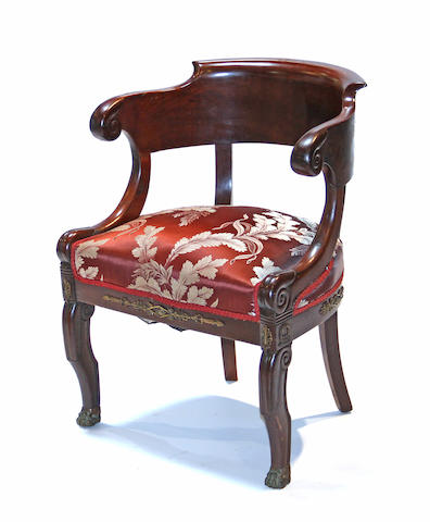 An Empire gilt bronze mounted mahogany fateuil de bureau 19th century