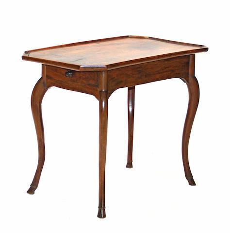 A Louis XV walnut table third quarter 18th century