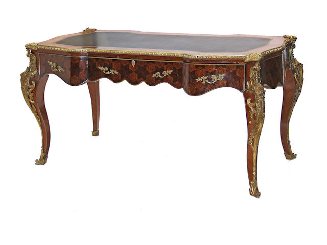 A Louis XVI style gilt bronze mounted and parqetry bureau plat