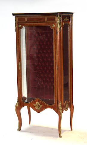 A Louis XVI style gilt metal mounted vitrine cabinet