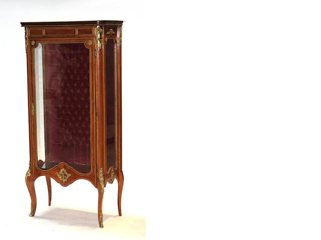 A Louis XVI style gilt metal mounted vitrine cabinet