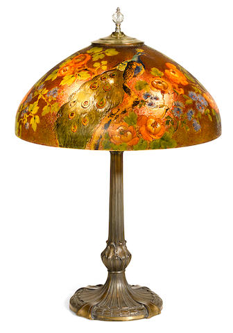 A Handel reverse painted glass and patinated metal Peacock lamp model 7126, first quarter 20th century