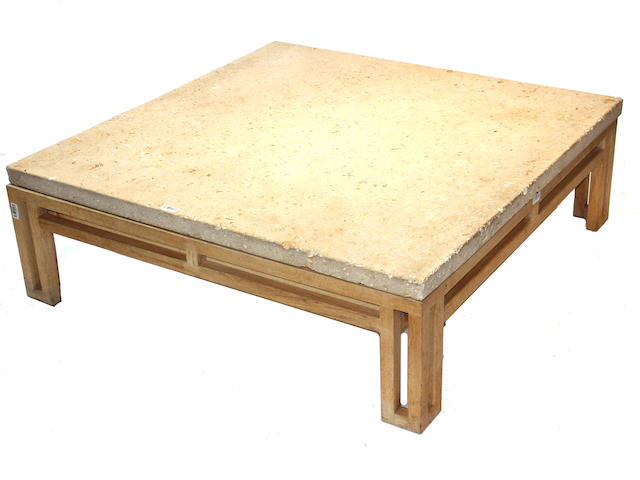 A contemporary cast stone and oak coffee table