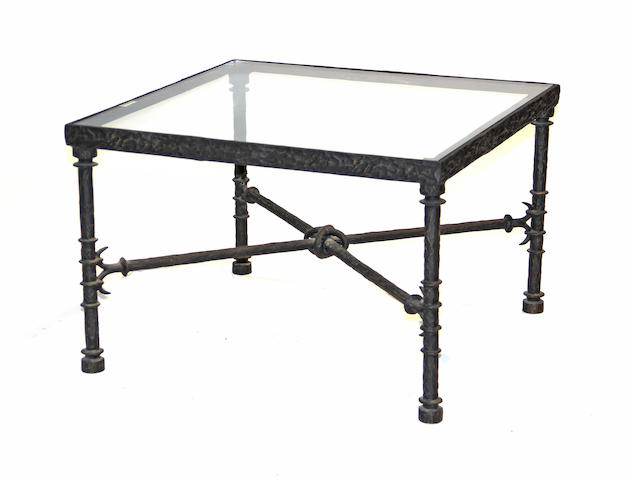 A contemporary iron and glass coffee table