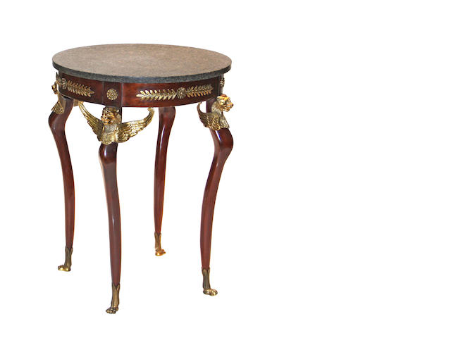 A pair of Empire style gilt bronze mounted mahogany gueridons