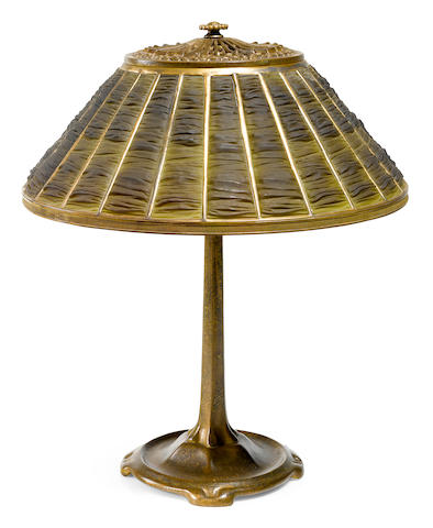 A Tiffany Studios Favrile glass and gilt bronze linenfold table lamp circa 1922