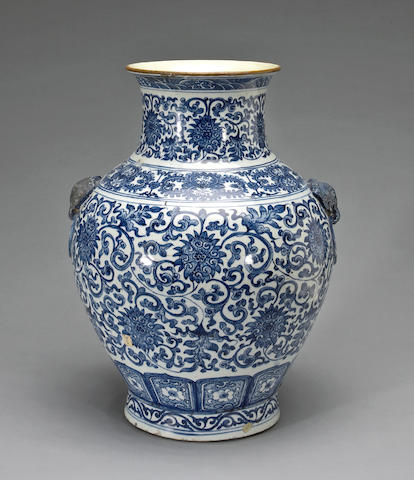 A large Chinese blue and white porcelain vase with emblem mask handles <BR />Quianlong mark, Republic period