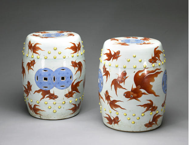 A pair of porcelain garden seats with swimming goldfish decoration late Qing dynasty