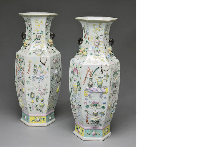 A pair of famille rose porcelain vases (drilled)