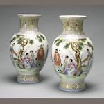 A pair of polychrome enameled porcelain vases Qianlong marks