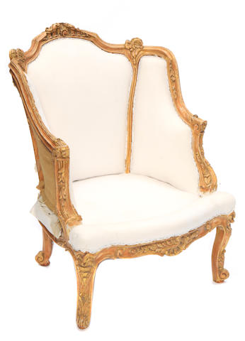 A Louis XV style parcel gilt and paint decorated petit bergère