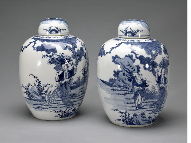 A pair of blue and white large lidded urns