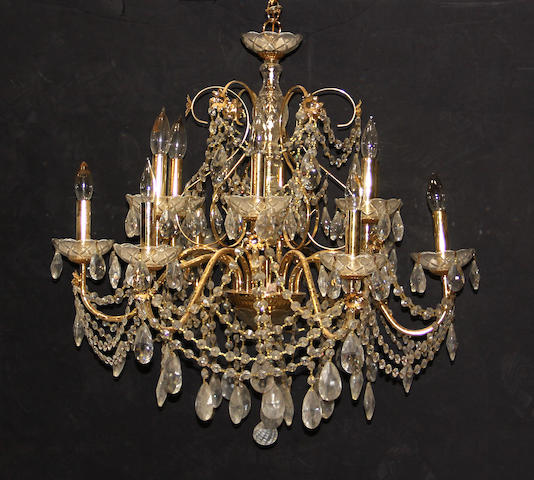 A pair of Neoclassical style brass and glass twelve light chandeliers late 20th century