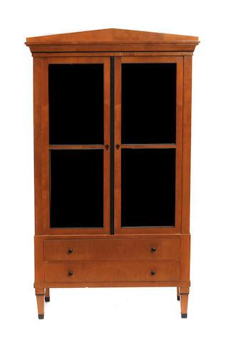 A Biedermeier style parcel ebonized birch cabinet