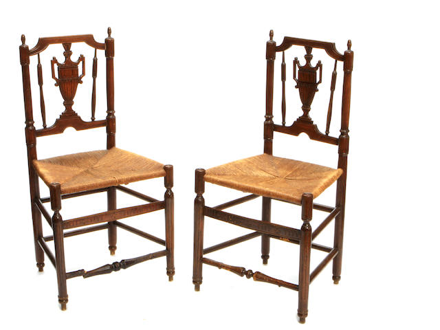 A set of four Louis XVI provincial beechwood and rush side chairs