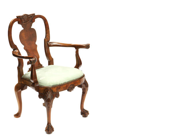 A George I style walnut balloon seat armchair