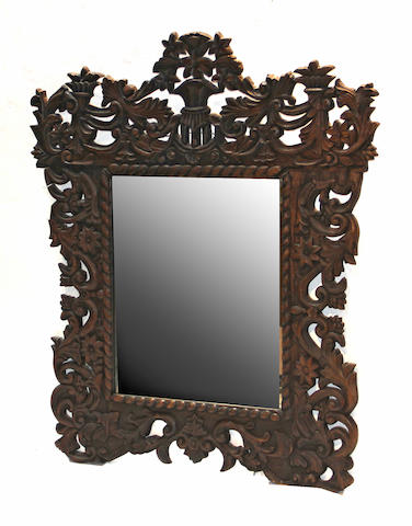 A Spanish Baroque style walnut mirror