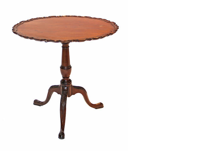 A George III mahogany pie crust top tea table