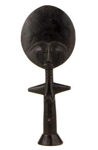 An Ashanti dolls, a Ku'aba