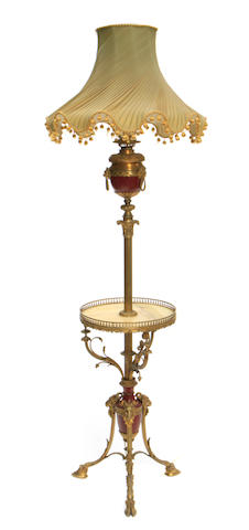 A Louis XVI style gilt bronze and onyx floor lamp