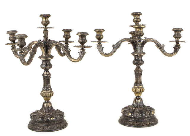 A pair of Continental Rococo style silver plate four light candelabra